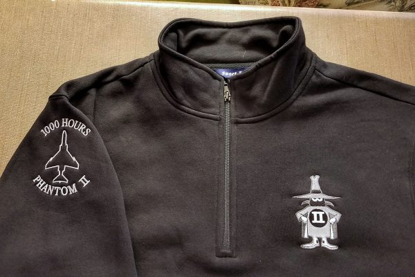 Quarter zip pullover with the F4 Phantom Spook embroidered on the left chest and the 1000 Hours flight time signifier on the right upper arm
