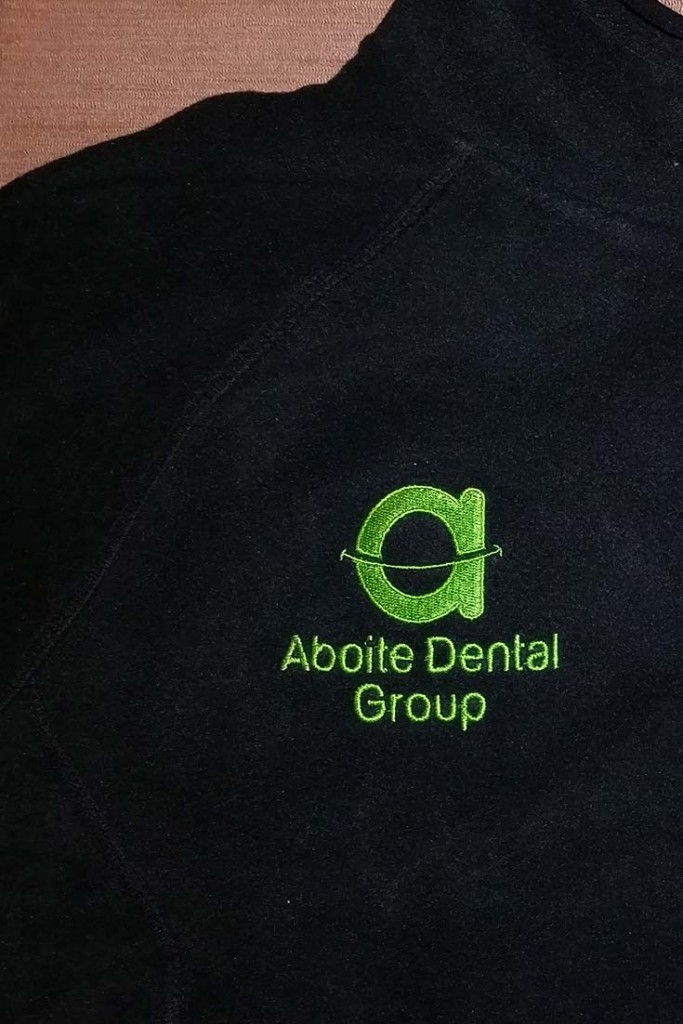 Aboite Dental Group Black Fleece with Green Embroidery