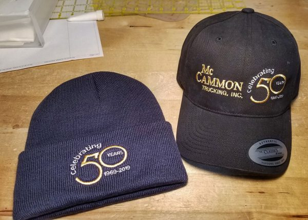 Knit Cap and Baseball Cap Embroidered with logos for McCammon Trucking Celebrating 50 Years