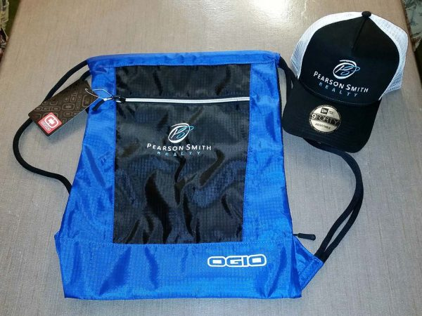 Cinch Pack and Baseball Cap embroidered with Pearson Smith Realty logo