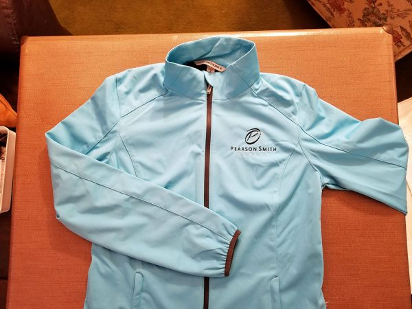 Jacket with Pearson Smith Realty logo embroidered on left chest
