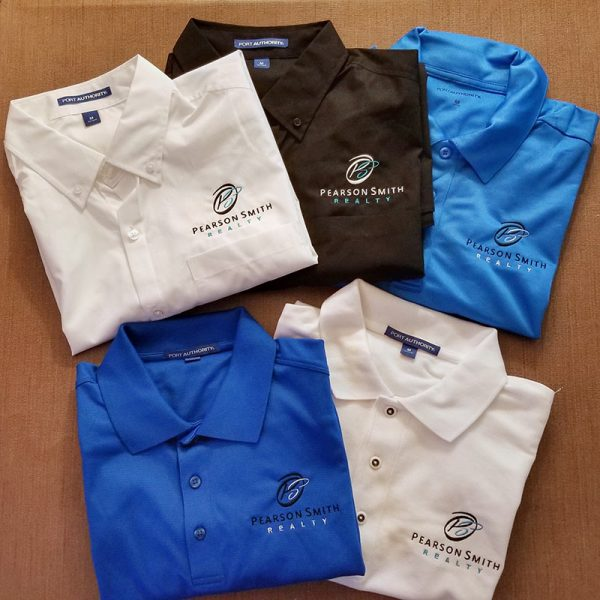 Polos and button-down shirts with Pearson Smith Realty logo embroidered on left chest