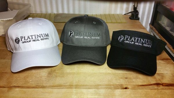 Custom embroidered baseball caps and visor for Platinum Group Real Estate